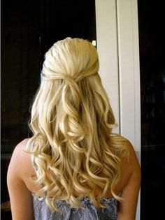 Wedding hair. Half up half down  With a hair clip that matches dress and jewelry