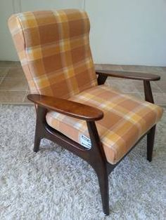 Mid century Danish furniture, restored arm chair reupholstered with a retro wool blanket.