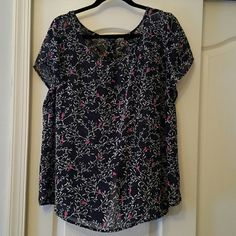 Cute top from Torrid Super cute top from Torrid sheer material buttons down the back colors are navy and white with fuchsia.  Torrid size 1 which is a 14-16 torrid Tops Blouses
