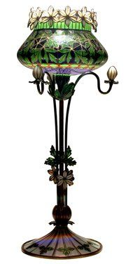 This plique-a-jour enamel and silver vase was offered for sale at Leo Kaplan Ltd. in New York City. It was made by Gustav Gaudernack while he was working at David-Andersen in Oslo, Norway, about 1900. It is 8 inches high.