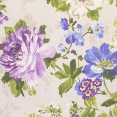 Luciano - Amethyst - Large bright blue and purple flowers printed with green leaves as a pattern on cream coloured cotton fabric