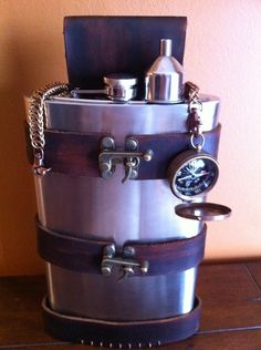 Leather Steampunk Flask Holder / Holster with 64 oz Flask. $48.00, via Etsy.