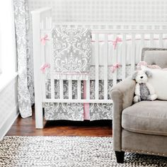 This set includes a lovely white on soft gray damask coverlet, piped sweetly in soft pink and trimmed in a ruffle of white that is accented with soft gray polka dots, encircled in matching gray, part of an extraordinary uniform print. #timelesstreasure