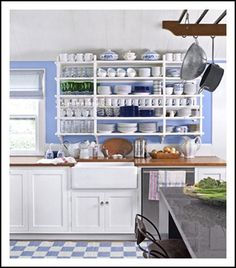 open shelf with blue and white plates and china