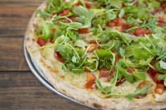 How about this healthy pizza tonight? Arugula leaves, slices of prosciutto, sliced tomatoes