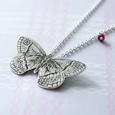 "Pendant | Simone Walsh.  ""Etched butterfly"".  Sterling silver with ruby"