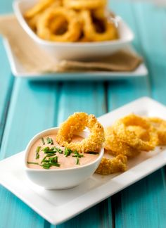 Quinoa Crusted Onion Rings with Spicy Dipping Sauce - These oven baked quinoa crusted onion rings are out of this world! The best way to get your snack on without blowing your diet. Gluten Free with a Vegan Option - WendyPolisi.com