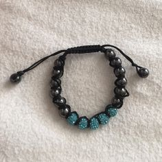 blue shamballa bracelet absolute perfect condition blue and black shamballa bracelet !! can be adjusted to fit. Jewelry Bracelets