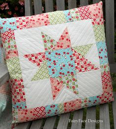 """Bliss pillow progress.... @ Fairy Face Designs: ...I also quilted and finished the scrappy star cushion. Looking at the V shape of the star points, I decided to try to echo it in the quilting, even though the star """"V""""s were not totally even. But I think it worked and I was pretty happy with how it turned out. The lines are 1/2"""" apart..."""
