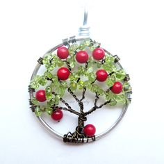 The Apple Tree- Wire Tree of Life in Green Peridot and Red Glass. $32.00, via Etsy.