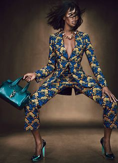 Don't know about this pose but that suit is pretty great.   naomi campbell photographed by emma summerton
