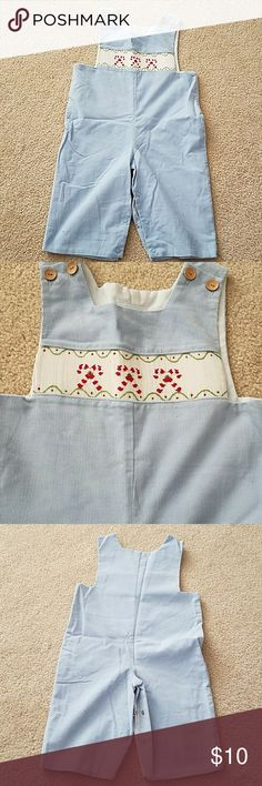 Holiday Corduroy Jumper Little English light blue corduroy jumper with snap inner leg closures. Embroidery has candy cane detail. One Pieces