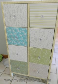 Mod Podge + Pretty Paper = Cute Dresser, Lots of mod podge, vintage inspired paper from a pack of 12 by 12 pad, measuring and cutting and I made over this dresser. , You can see more and a tutorial here http://www.mysimplehomelife.com/2011/09/mod-podge-pretty-paper-cute-dresser.html, Home Decor Project