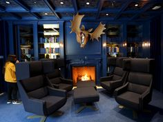 This cool, modern blue library in Ontario is full of books and its own fireplace...
