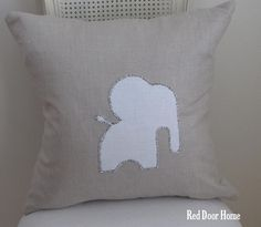 neutral nursery ...I kind of love elephants for baby rooms!