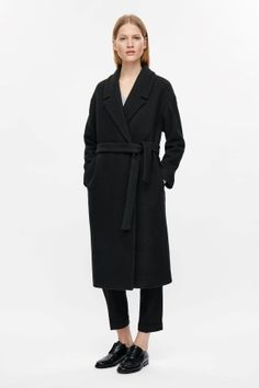 Belted wool coat. Black minimalist outfit | Black minimalist coat | Black classic pants | Minimalist woman | Minimalist style | Capsule wardrobe | Intentional living | Slow fashion | Simplicity | Less is more