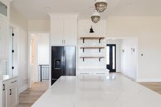 Exclusive Open Concept 2-Bed New American Farmhouse with Home Office - 365005PED | Architectural Designs - House Plans White Built Ins, Black Kitchen Island, American Farmhouse, Open Concept Floor Plans, Building Section, Home Room Design, Walk In Pantry, Great Rooms, Home Office