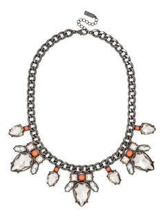 The pop that your new spring wardrobe is waiting for: Glimmering, high-shine jewels accent a shiny curb-link chain, punctuated with opaque neon stones for a shock of bright color.