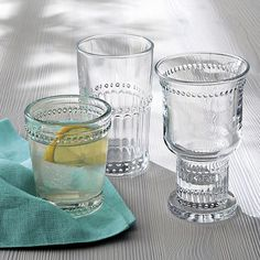 Raised dots and scalloped details nod to traditional pressed glass in fresh new shapes that give a contemporary hold on all kinds of beverages.