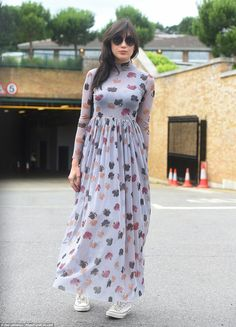 Model Daisy Lowe wore a gauzy lilac dress decorated with blue, red and brown leaves paired...
