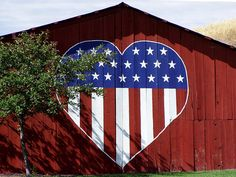 patriotic heart on red barn