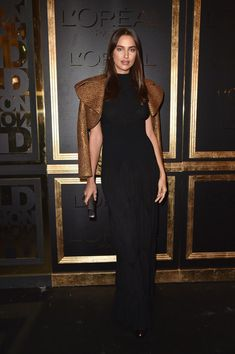 Irina Shayk attends the Gold Obsession Party - L'Oreal Paris : Photocall as part of the Paris Fashion Week Womenswear  Spring/Summer 2017  on October 2, 2016 in Paris, France.