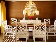 Mary McDonald. grassweave walls, wood tone table with white chairs