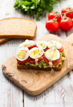 Healthy Avocado, Tomato, and Egg Toast. This open-faced sandwich is perfect for breakfast or lunch. | www.themessybakerblog.com @jlphaneuf