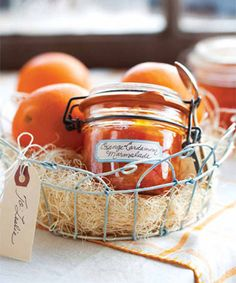 This preserved marmalade can be spooned over buttered toast, spread on a brioche roll or croissant, or dolloped on a toasted English muffin spread with fresh goat cheese. Include it in a wire basket with gift basket filler and fresh oranges. Chutneys, Garam Masala, Diy Christmas Baskets, Christmas Diy, Christmas Presents, Marmalade Recipe, Diy Gift Baskets, Raffle Baskets, Basket Gift