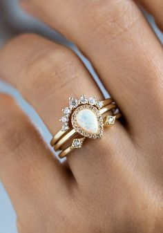 The Pear Stacking Ring Set in Gold with White Opal is simply regal. The center pear shaped opal is set in a halo of pave CZ, with an open stacking ring that hugs the peak, and a major nesting crown topper ring. White Opal, White Gold, Cute Jewelry, Jewelry Accessories, Engagement Ring Settings, Boho Engagement Ring, Stacked Engagement Ring, Cute Rings, Wedding Bands