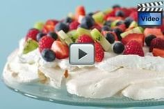This meringue cake, with its unusual soft sweet marshmallow center and crisp crust is produced by folding a little vinegar and cornstarch into stiffly beaten egg whites.   From Joyofbaking.com With Demo Video