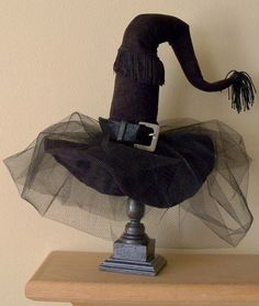 Witch Hat with tulle upon a candle stick. Quick and | http://doityourselfcollections.blogspot.com