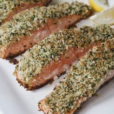 2/3 cup panko (Japanese dried bread flakes) 2 tablespoons	minced fresh parsley 1 teaspoon grated lemon zest Kosher salt and freshly ground black pepper 2 tablespoons good olive oil 4 (6- to 8-ounce) salmon fillets, skin on 2 tablespoons Dijon mustard 2 tablespoons	vegetable oil Lemon wedges, for serving