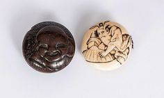 A set of 2 Manju netsuke, Japan, c. 1900. Ivory and boxwood, carved and partly with black engraving. 2 pieces: figure with hat (diameter 4 cm, sign.), face of a laughing Hotei (diameter 4,5 cm).