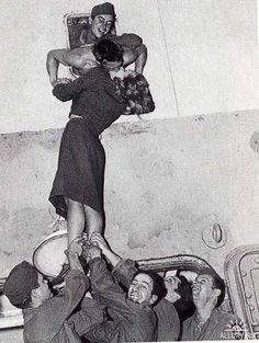 I love this so much. Also, love that the men are holding the woman up, but they have the decency not to look up her dress!!! :)