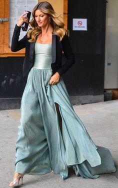 Trending Fashion Style: Men's Tuxedo Jacket over the Dress. Gisele Bundchen in cropped black tuxedo blazer over Jeff Garner strapless sage green gown + strappy silver sandals heading to the Rainforest Alliance Gala at the American Museum of NaturalHistory in New York City May 2014.