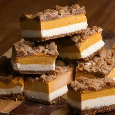 Pumpkin Cheesecake Bars Recipe by Tasty; Crust: ground up pecans and almond flour and some sugar, melted butter and bake at 425 for 5 min; cream cheese was overwhelming so more pumpkin or less cream cheese; add pumpkin spice to cream cheese Just Desserts, Delicious Desserts, Yummy Food, Pumpkin Recipes, Fall Recipes, Dip Recipes, Recipes Dinner, Chicken Recipes, Summer Recipes