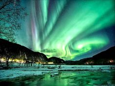 An aurora is a natural light display in the sky, caused by the collision of solar wind and magnetospheric charged particles with the high altitude atmosphere (thermosphere) Aurora Borealis, Natur Wallpaper, Beautiful World, Beautiful Places, Northern Lights Tours, Natural Phenomena, Natural Wonders, Amazing Nature, It's Amazing