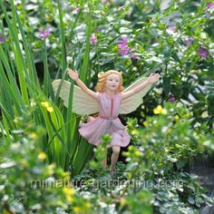This site also has large scale faerie garden ideas!