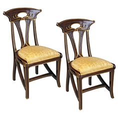 Features:  -Set includes 2 chairs.  -Hand carved solid mahogany.  -Hand finished.  -Hand upholstered.  Frame Finish: -Brown.  Frame Material: -Wood.  Seat Frame Material: -Wood.  Number of Items Inclu