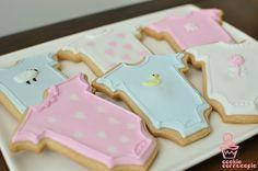 baby shower cookies, onesies with sweet, subtle details (ducks, sheep, hearts, flower)