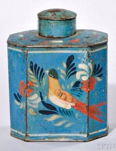Skinner's - Ellie Hoover Collection.  August 9, 2015 Lot 1004.   Estimate $800-1,200.   Realized: $1,230.        Description:   Paint-decorated Tin Tea Caddy, early 19th century, octagonal form with a long-tailed bird amongst leaves in red, cream, and blue, all on a blue ground, (minor wear especially on top), ht. 4 3/4 in.