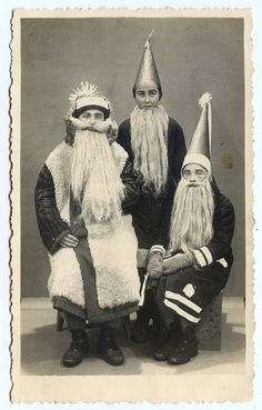it was the night before christmas , vintage photo of kids dressed as Santa.