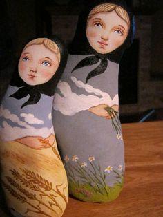 Sister Babushka dolls representing the growing season and harvest.