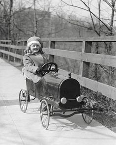 Little Girl Driving Pedal Car 1922. Vintage Photo by HistoryPhoto