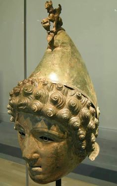 Parade or ceremonial helmet. Found in Britain. Shows a youth wearing a Phrigian cap toped by a griffin