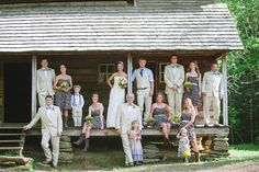This is how I want my family pictures! Instead of really formal pictures, casual in front of an old cabin.