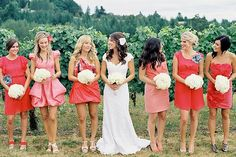 love the different shades of bridesmaids dresses.