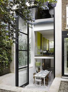 double storey bi folding door allows this lucky home owner to open up the 1st floor as well as the ground floor - notice the glass balcony on the 1st floor that ensures no one falls off unexpectedly ! Great home extension design.
