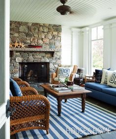 Casual nautical cottage living room in blue and white, with wood and wicker.